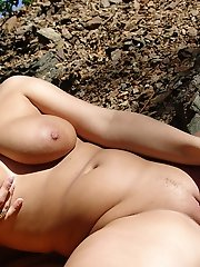 Vendy plays with her funbags and toy fucks her cunt outdoors