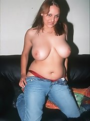 Sexy amateur in blue jeans with large love melons stripping